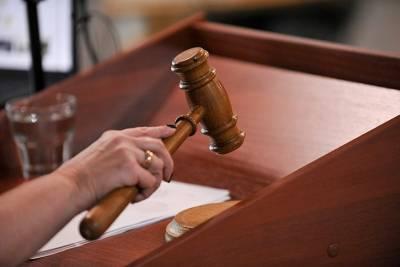 Столичный суд осудил девять человек за грабежи и избиения до смерти