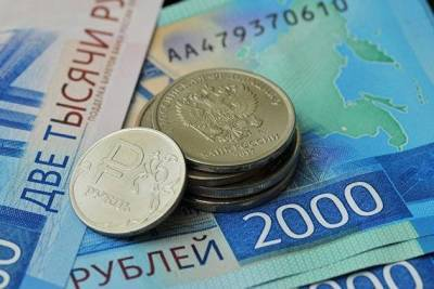 Рубль символически укрепляется перед встречей Путина и Байдена
