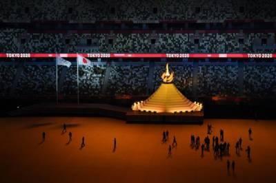 Огонь Олимпийских игр зажгли на церемонии открытия в Токио